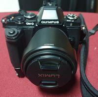 Olympus OM-D E-M5 с два ГРИП-а, две батерии и обектив.