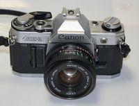 Фотоапарат Canon AE-1+ обектив Canon FD 50mm F1.8