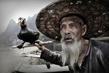 Mr Huang Quan De - 82 years old fisherman and his assistant ; comments:125
